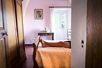 Legs of man resting on bed. Santo-Pietro-di-Tenda, Corsica, France.