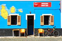 Exterior wall of a local shop with the maps of Santiago, Maio and St Luzia painted on it, Palmeira, Cape Verde, Africa.