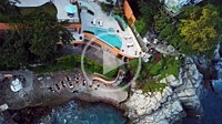 Yoga retreat in a villa at the Mexican Pacific coast with people exercising