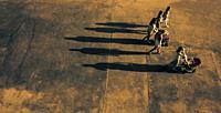 group of people with projected shadow, Valencia, Spain