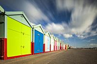 Beach huts on the seafront of Brighton and Hove, England.