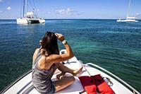 Tourist on a boat, journey in Saona island, Dominican Republic.