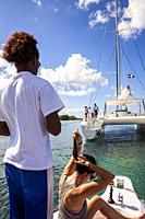 Tourists on a boat, journey in Saona island, Dominican Republic.