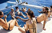 Tourists on a catamaran, journey in Saona island, Dominican Republic.