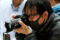 March 3, 2018, Yokohama, Japan - A man tries out an Olympus camera at the CP+ Camera & Photo Imaging Show 2018 in Pacifico Yokohama. Japan's largest c...