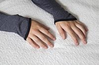 Hands of a teenage girl.