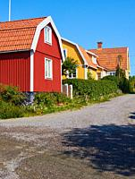 Community of traditional colourful timber houses, Sweden, Scandinavia.