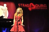 Attractive singer in red on stage at Strasbourg my love