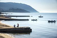The beach at Ouranoupoli, (looking towards the Athos Peninsula) Chalkidiki, Macedonia, Northern Greece.