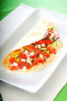 fresh homemade salad wrap on pita bread,very healthy food.