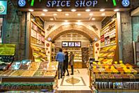 Customers peruse the shelves of a spice shop at Istanbul Spice bazaar in Turkey.