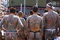 Participants showing their full body tattooed, possibly members of the Japanese mafia or Yakuza, attend the Sanja Matsuri in Asakusa district on May 2...