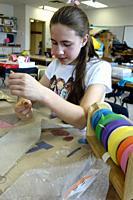 6th Grade Girl Working on Art Project, Wellsville, New York, USA.