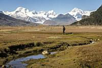 A person exploring the interior of Ainsworth Bay, in background Cordillera Darwin, PN Alberto de Agostini, Tierra del Fuego, Patagonia, Chile.