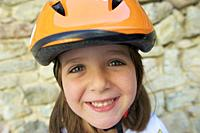 Portrait of a girl with protective helmet.