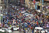 DHAKA, BANGLADESH - JUNE 12 : Traffic jam and peoples crowd seen at New Market area during the Ramadan in Dhaka , Bangladesh on June 12, 2018. . Last ...