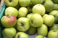 Green Apple Background on Market Stall,.