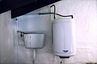 Close up of the cistern WC and boiler in a bathroom. Mahon, Menorca, Baleares, Spain.
