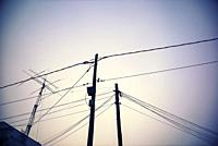Electricity Pylon and power lines at sunrise. Mahon, Menorca, Baleares Spain.