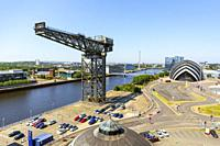 View west along the River Clyde with the Anderston Crane, the Armadillo concert hall, part of the Scottish Exhibition and Conference Centre, BBC and S...