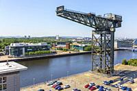 Finnieston crane, overlooking the River Clyde and the STV Scottish headquarters, Anderston, Glasgow, Scotland.