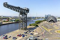 View west along the River Clyde with Finnieston Crane, Anderston and the SECC Armadillo convert venue and across the river to Govan District, Glasgow,...
