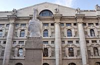 Milan, Italy: L.O.V.E. (´The Finger´) sculpture by Maurizio Cattelan, facing Palazzo Mezzanotte (Stock Exchange Building) in Piazza degli Affari