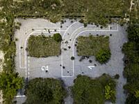 Aerial view of an abandoned parking lot in a rural area already invaded by the vegetation of the area.
