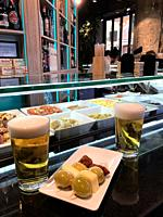 Two glasses of beer and tapa in a bar. Madrid, Spain.