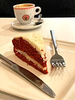 Piece of carrot cake and cup of coffee.