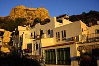 Houses in the neighborhood of Santa Cruz and in the background the Castle of Santa Barbara in Alicante, Valencia, Spain