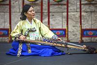 Musician plays gayageum, traditional instrument, at Korean Festival, Getty Center, Los Angeles CA.