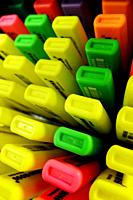 A display of highlighters in various colors for sale in an office supply store.