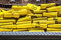 Folded yellow fire hoses.