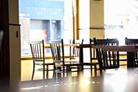 Empty tables and chairs in a restaurant.