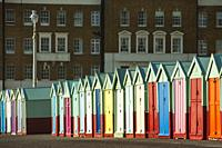Colourful beach huts on Hove seafront, East Sussex, England.