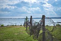 Suspended fishing nets in Nyord Havn on Nyord Island, Denmark, Scandinavia, Europe. Aufgehängte Fischernetze im Hafen von Nyord auf der Insel Nyord, D...