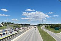 Canada, Alberta, Calgary. Highway on the outskirts of the city. Light rail public transportation (C train) station on the left.