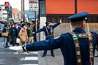 23. 12. 2017, Kyoto, Japan, Asia - Traffic wardens are seen regulating the flow of traffic at an intersection in Kyoto's old city.