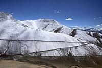 Switchbacks up the snowy Chang La Pass, above the Stok Range and Indus Valley, Ladakh, India.
