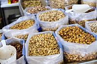 Peanuts and quicos (toasted maize) for sale in market. Valencia, Spain