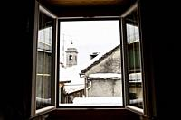 Looking out the window at the winter landscape. Domodossola, Piedmont. Italy.