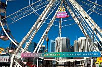 Sydney, New South Wales, Australia - A view of Sydney´s cityscape with the central business district as it is seen through a big wheel at Darling Harb...
