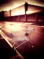 Lost or abandoned shopping trolley on an industrial estate in Cheshire England UK