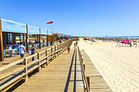 Wooden boardwalk promenade along the beach at Monte Gordo, Algarve, Portugal.
