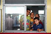 """Boys in train station, waiting for the """"""""toy train"""""""" (a small narrow-gauge train) to leave to Shimla."""