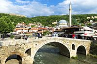 Stone bridge over Bistrica river and Sinan Pasha Mosque, Prizren, Kosovo.