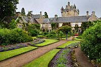 Wet Flower Garden with purple perennial flowers south of Cawdor Castle after rainfall in Cawdor Nairn Scotland UK.