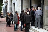 Daily life in Athens. Pensioners are waiting in line to be served at the public service.