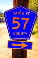 Santa Fe 57 County road marker in Los Cerrillos, NM.